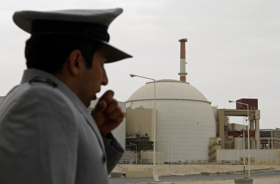 A guard stands in front of the controversial Bushehr nuclear power plant in Iran.