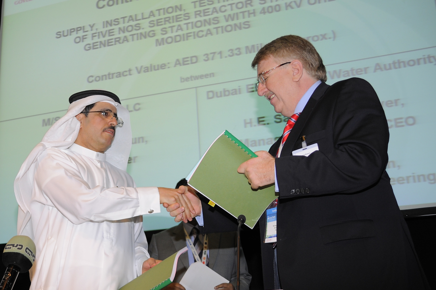 H.E Saaed Mohammed Al Tayer, MD and CEO, DEWA  and Mr Wolfgang Braun, Siemens.