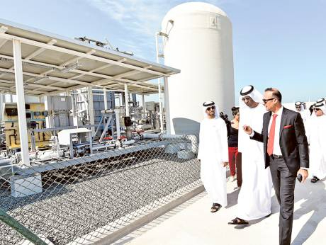 Dr Sultan Al Jaber and Suhail Al Mazroui, Minister of Energy, take a tour of the Masdar Renewable Energy Desalination Pilot Plant after its inauguration