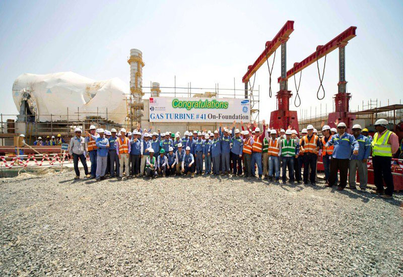 EMAL employees celebrate the arrival of the first turbine at the Phase II project.