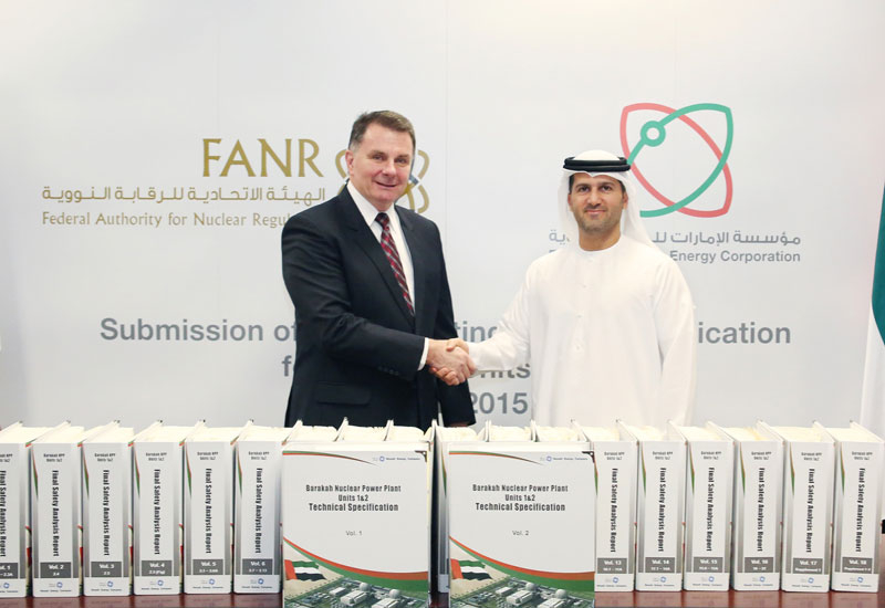Mohamed Al Hammadi, delivers the OLA to FANR Director General, William Travers