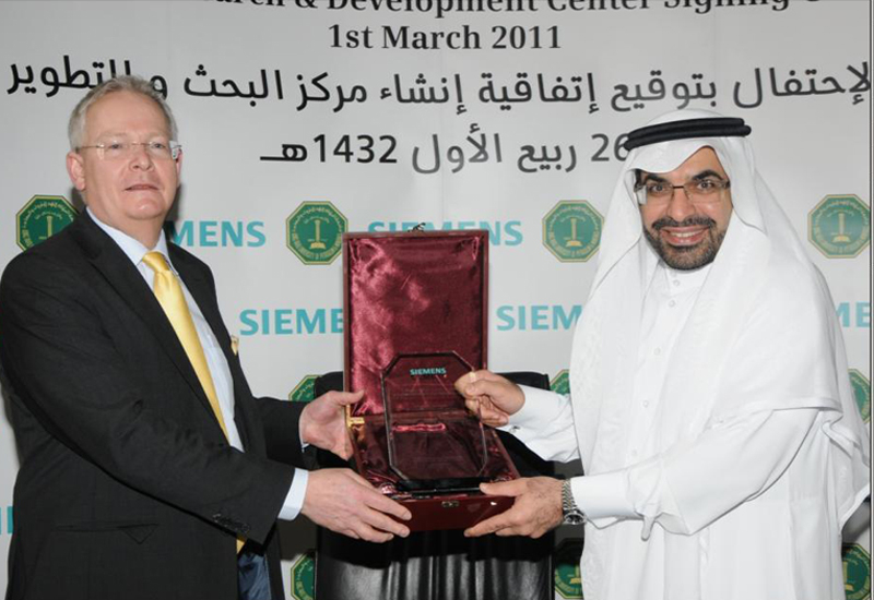 Wolfgang Dehen, CEO of Energy Sector, Siemens and Dr. Khaled Al-Sultan, Rector and CEO of KFUPM after the signing ceremony. (Getty Images)