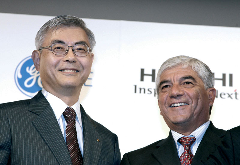 Kazuo Furukawa (L) smiles with Rudolph Villa as they announce an agreement to create a global alliance for their nuclear business.