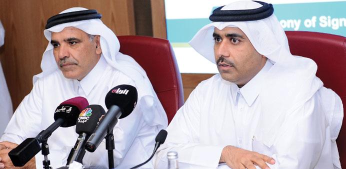 Kahramaa President Issa bin Hilal al-Kuwari (right) and QEWC General Manager Fahd al-Mohannadi