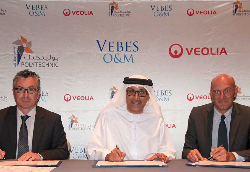 Signing the MoU.