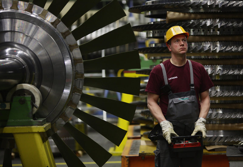 The new JV aims to better compete with international power giants such as Siemens and GE. (GETTY IMAGES)