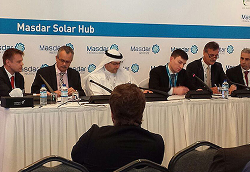 ABB's Carlos Pone signs the deal with Masdar