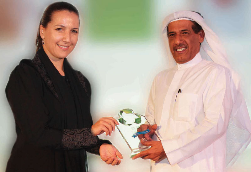 Salim Bin Mohammed Al Owais, chairman, Bee?ah, receives an award at the Green Middle East Exhibition and Forum
