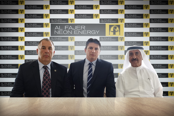 Sheikh Hasher (right) and Gianniotis (centre) at the signing ceremony