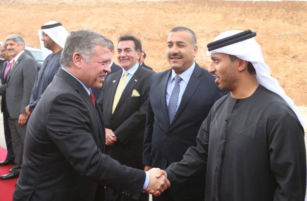 King Abdullah II greets senior officials at the launch of Tafila wind farm