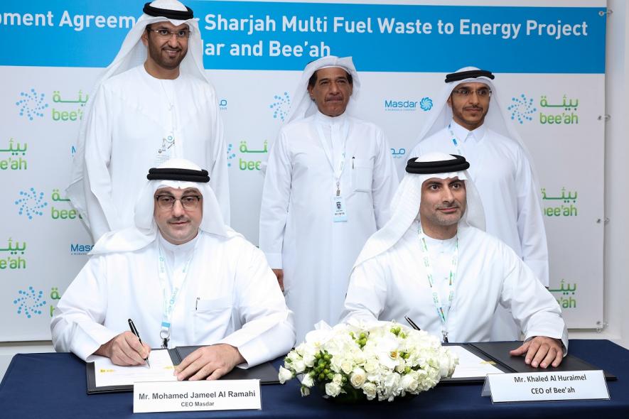 Masdar CEO Mohamed Jameel al Ramahi with Bee'ah CEO Khaled Al Huraimel