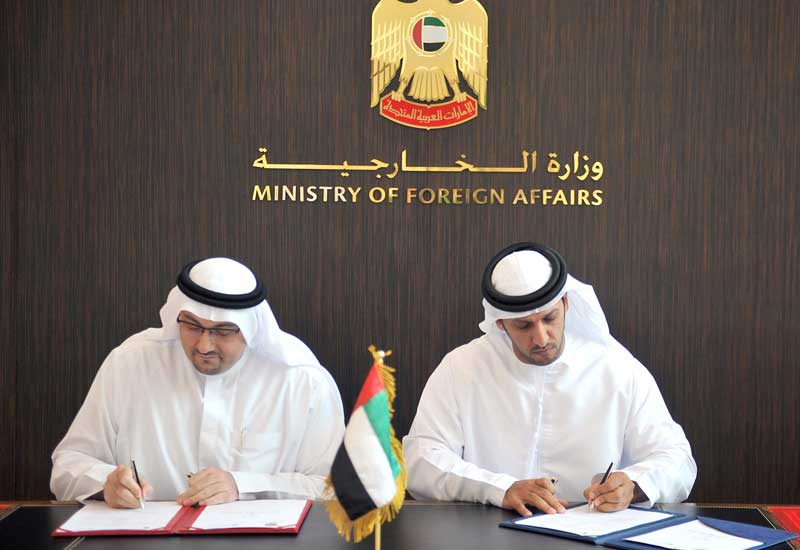 Masdar and Foreign Ministry officials signing the MoU.