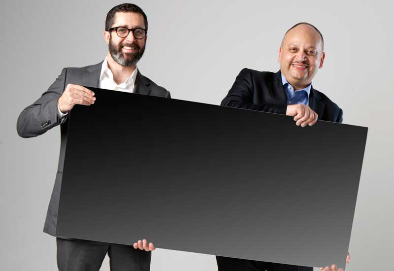 L-R: First Solar's Matt Merfert and Ahmed Nada with a Series 3 Panel.