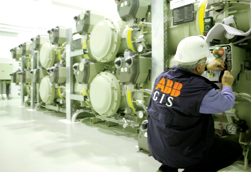 An ABB engineer conducts routine maintenance on a gas-insulated switchgear at Dubai's international airport.