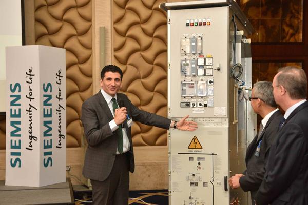 Siemens Qatar's CEO Sakiz ... showcasing the new switchgear at the launch event
