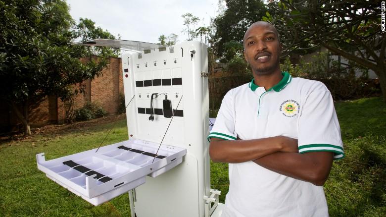 Solar energy innovator Henry Nyakarundi with his portable mobile charging Kiosk in Rwanda