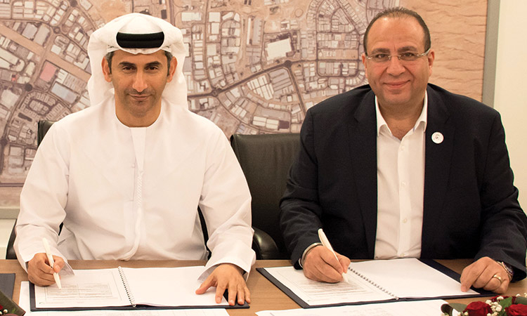 DIP General Manager Omar Al Mesmar and Dr. Mostafa Al Guezeri, MD UAE, Gulf and Near East for ABB Industries sign the contract