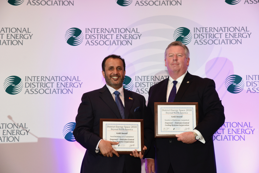 Ahmad Bin Shafar (left), CEO of Empower, receives the award