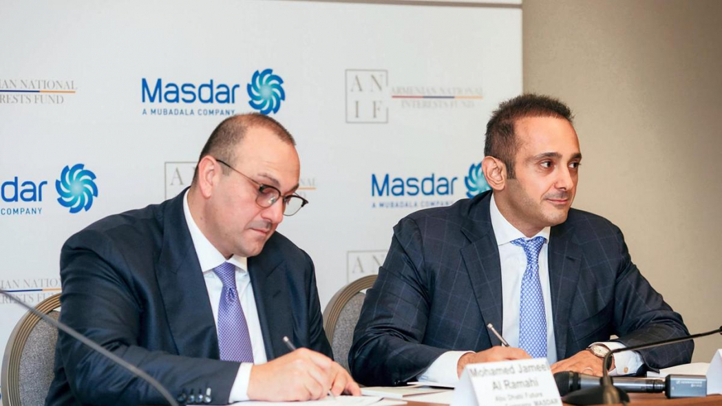 Mohamed Jameel Al Ramahi, chief executive of Masdar, and David Papazian, chief executive of the Armenian National Interests Fund (ANIF), sign a preliminary agreement to explore collaboration in renewable energy. Courtesy Masdar