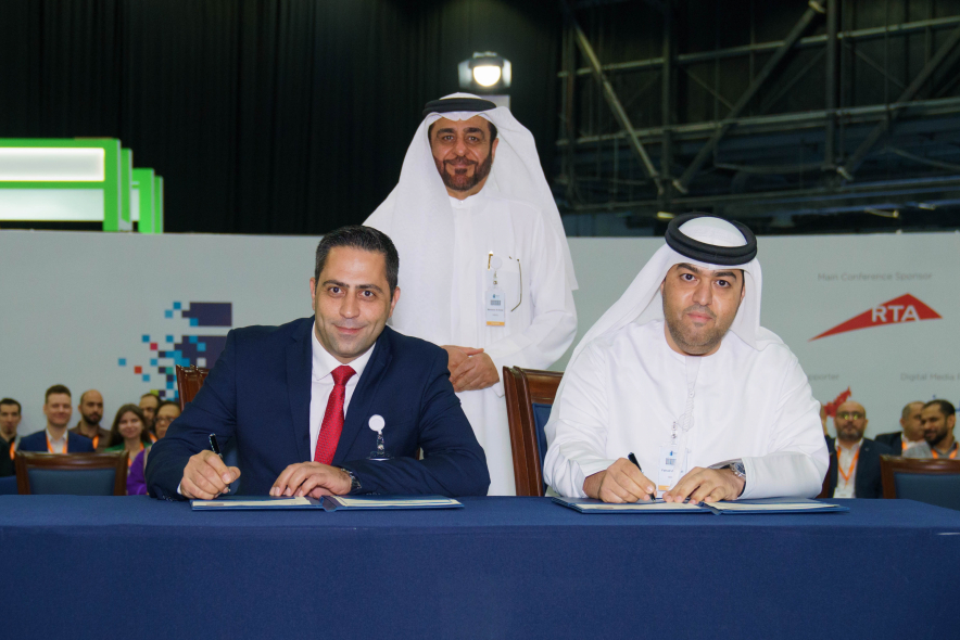 Dr. Fahad Al Saadi, Vice Chancellor for University Advancement, Hamdan Bin Mohammed Smart University (HBMSU) (right) and George Bou Mitri, vice president and general manager, Honeywell Building Technologies, Middle East, Turkey and Africa (left) sign a Memorandum of Understanding (MoU) at Innovation Arabia 2020 to leverage Honeywell Forge as an IoT platform to adopt advanced Artificial Intelligence, Machine Learning and data analytics across the University's campus. Dr. Mansoor Al Awar, Chancellor of HBMSU (standing), presided over the signing.