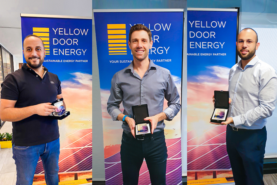The first employees at Yellow Door Energy mark their 5-year anniversary
